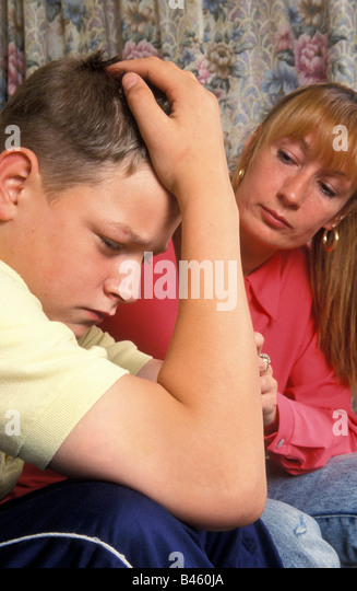 mother arguing or consoling her young son - Stock Image