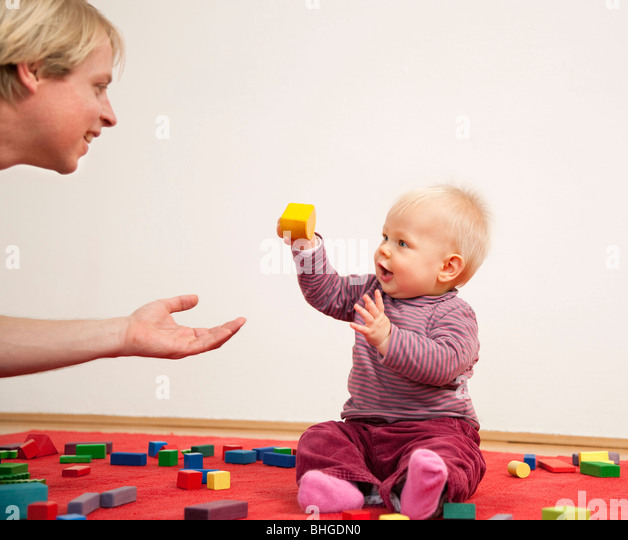 father and baby playing together - Stock Image