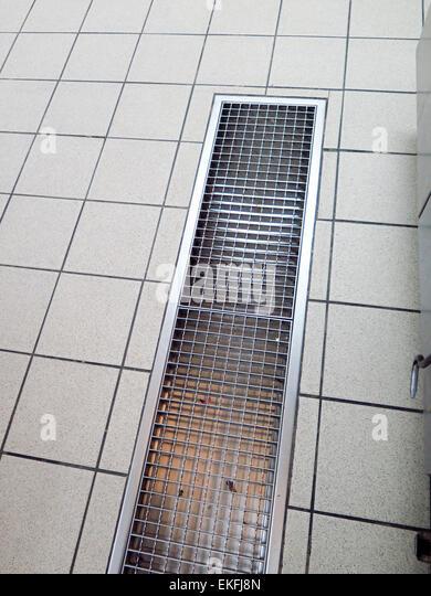floor drain in commercial kitchen stock photos floor