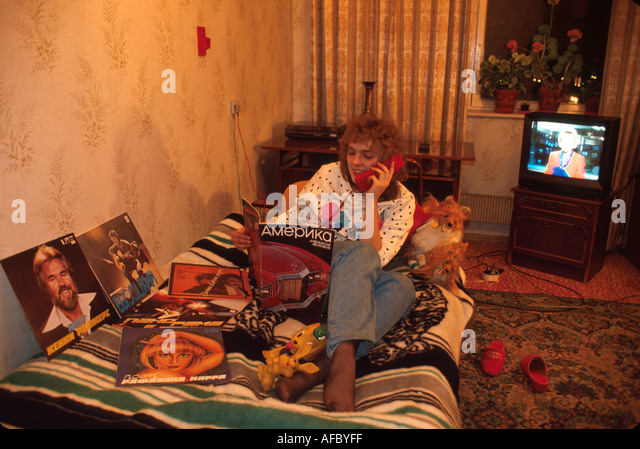 Russia former Soviet Union Moscow teen bedroom using phone record albums - Stock Image