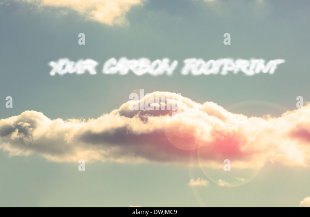 Your carbon footprint against bright blue sky with cloud - Stock Image