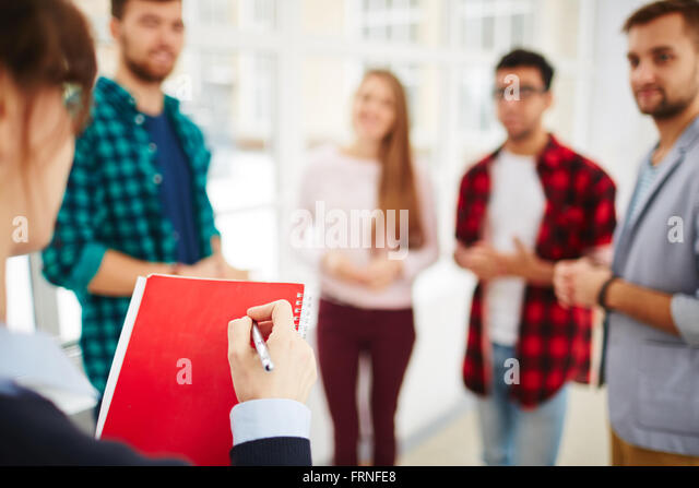 Teacher with notepad and pen - Stock Image