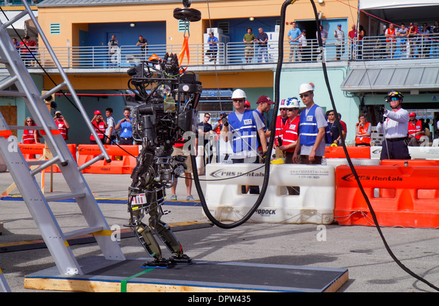 Miami Homestead Florida Speedway DARPA Robotics Challenge Trials remote controlled robot robots man student engineering - Stock Image