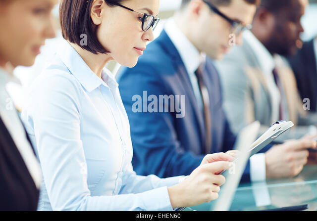 Row of people at meeting - Stock Image