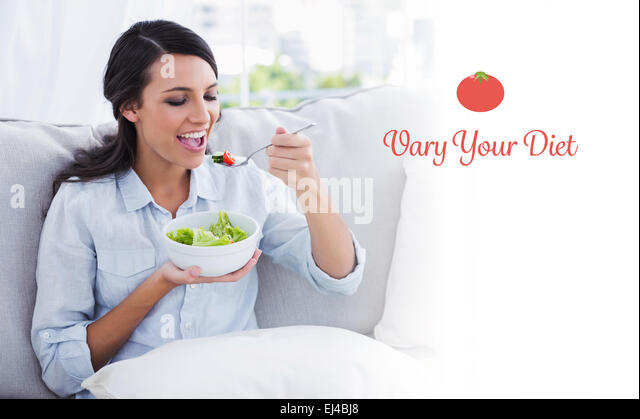 Vary your diet against happy woman relaxing on the sofa eating salad - Stock-Bilder
