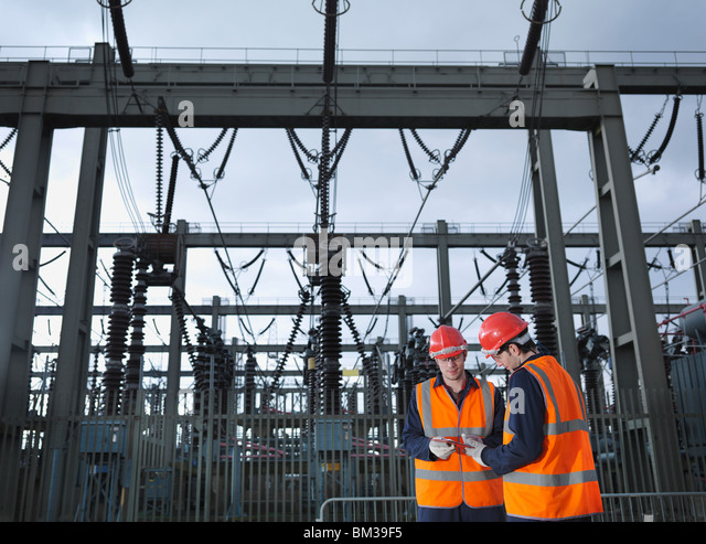 Workers At Electrical Switching Station - Stock Image