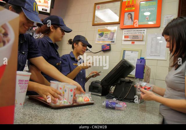 Mendoza Argentina Avenida San Martin McDonald's fast food restaurant business global company counter Hispanic - Stock Image