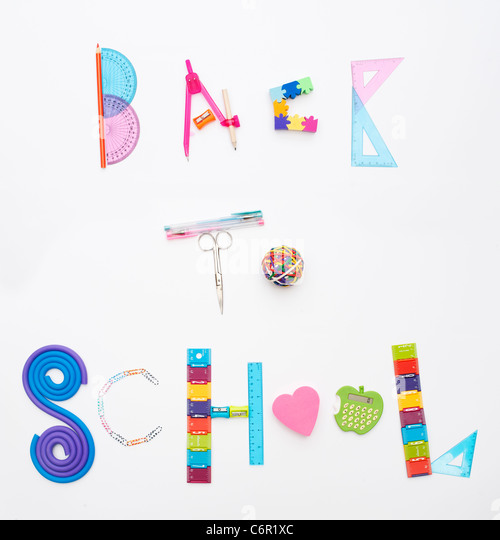 Back to school using childrens school stationary on white background - Stock Image