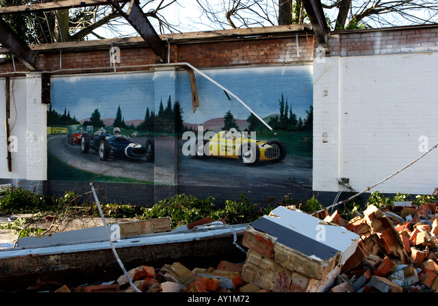 Wall painting of racing cars in a pulled down building - Stock Image