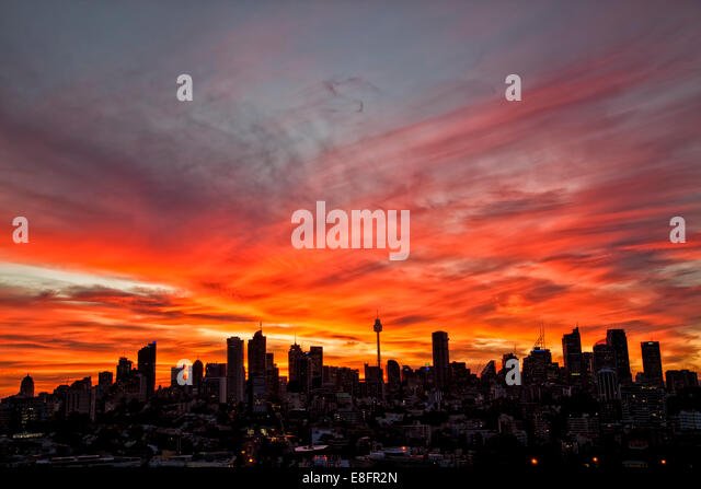 Australia, Sydney, Downtown skyline at sunset - Stock Image