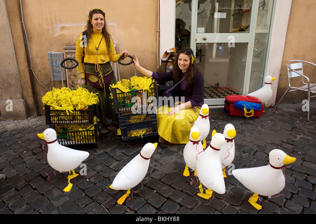 Women sell plastic ducks on 'Woman's Day' in Rome, March 8, 2008. Photo/Chico Sanchez - Stock Image