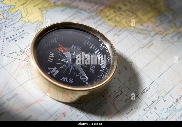 Compass On A Map - Stock-Bilder