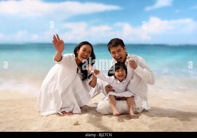 Portrait of family on beach - Stock Image