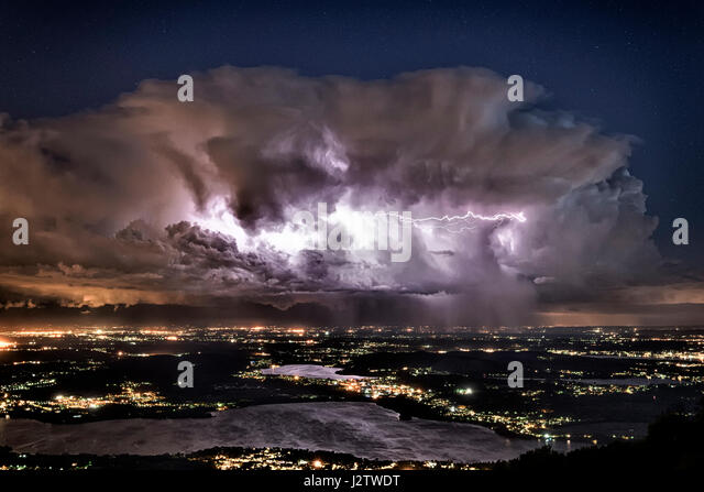 Storm clouds over the Province of Varese seen from the mountain Campo dei Fiori, Lombardy - Italy - Stock Image