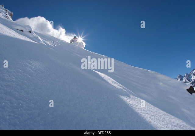 A skier carves in perfect powder in Chile. - Stock Image