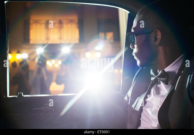 Celebrity in limousine arriving at event - Stock Image
