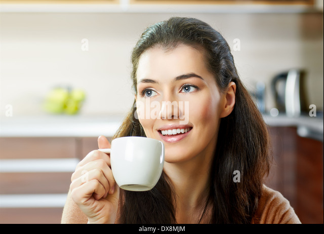 a beauty girl on the kitchen background - Stock Image