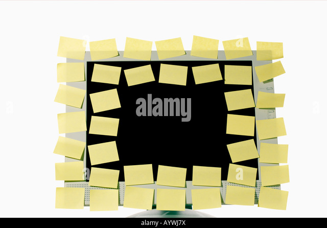 Lot of adhesive labels on a monitor - Stock Image