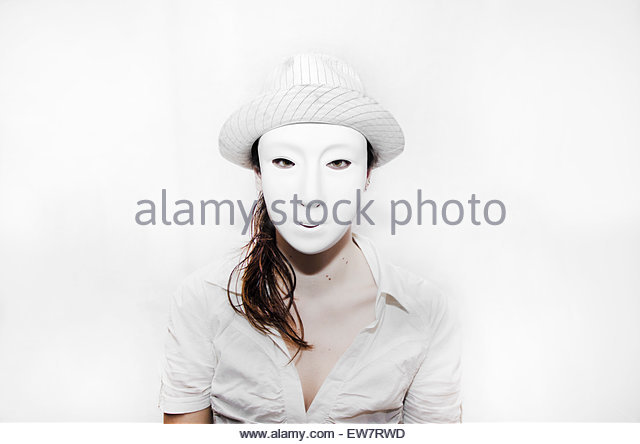 Portrait of a woman wearing a white mask - Stock Image
