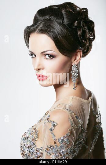Prosperity. Luxury. Glamorous Showy Woman with Diamond Earrings - Stock Image