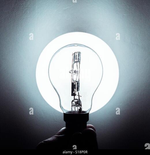 Lightbulb illuminated - Stock-Bilder