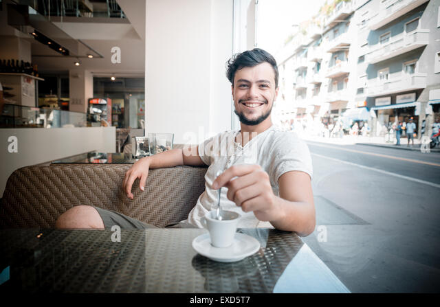 young stylish man at the bar drinking coffee - Stock Image