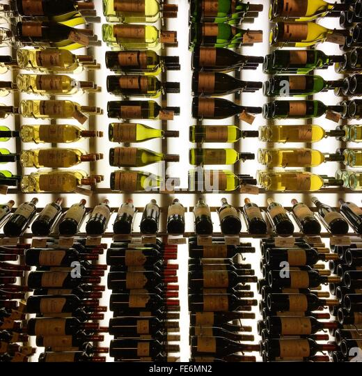 Wine Bottles On Shelves - Stock Image