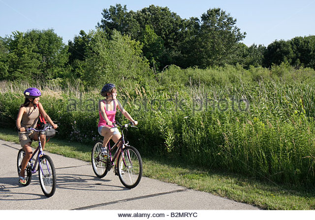 Wisconsin Kenosha Kansasville Richard Bong State Recreation Area Sunrise Campground Asian teen girl bike path bicycle - Stock Image