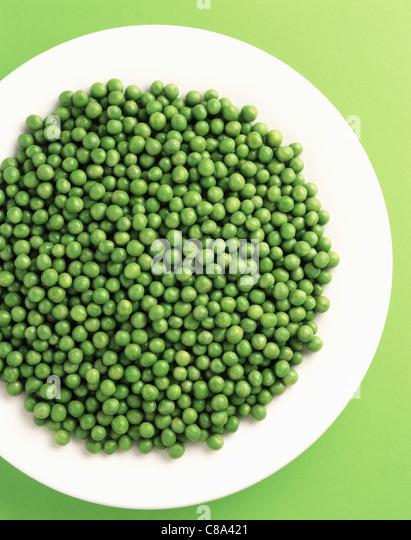 Plate of peas - Stock Image