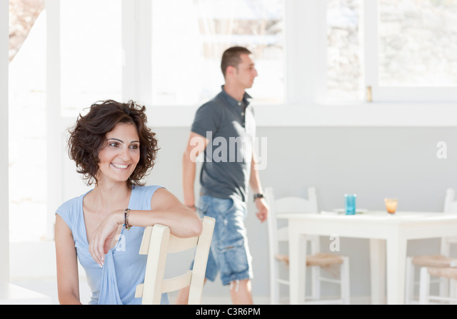 couple in movement in a restaurant - Stock Image