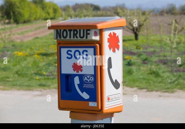 Breisach, Germany - April 07, 2017: Emergency telephone at the roadside, operated by the german Automobile Club - Stock Image