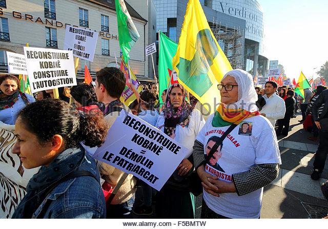 Paris, France. novembre 1st, 2015. FRANCE, Paris: A woman holds a banner reading Rebuild Kobane = demolish the patriarchy - Stock Image