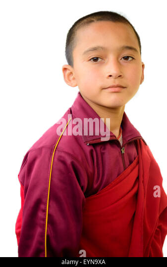 Portrait of a young Buddhist lama, monk with copy space isolated on white background - Stock Image
