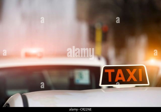 Close up of taxi sign on cab roof - Stock Image