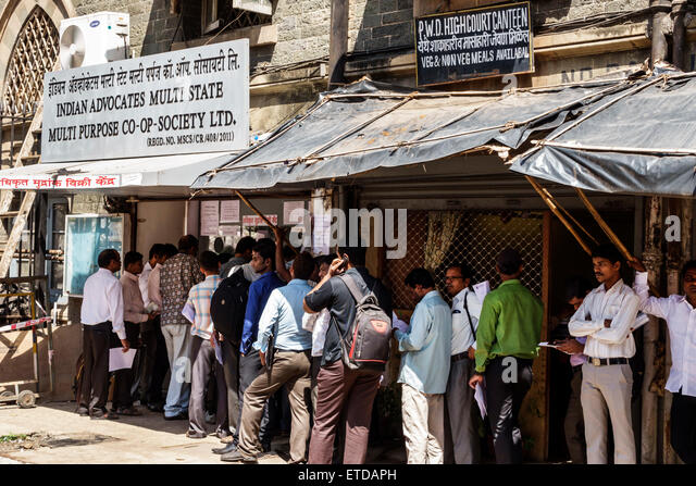 India Indian Asian Mumbai Fort Mumbai Dr. Kane Road Bombay High Court line queue man waiting entrance - Stock Image