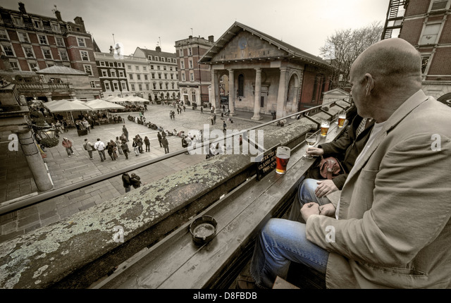 Drinking in the Punch & Judy, looking over Covent Garden London - Selective Colour - Stock Image