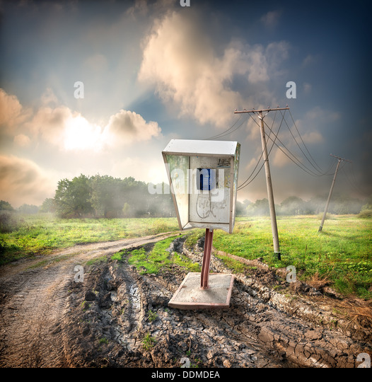 Old payphone on a road in the field - Stock Image