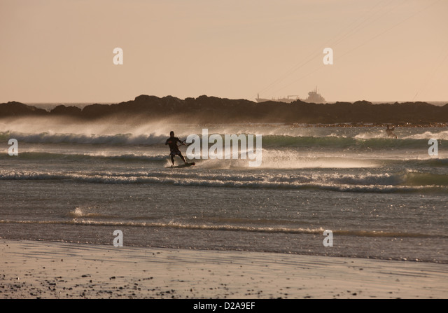 Man windsurfing in waves - Stock Image