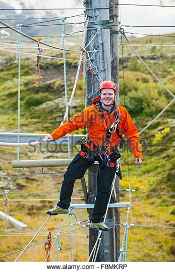 Man balancing at high rope access course, Iceland - Stock-Bilder