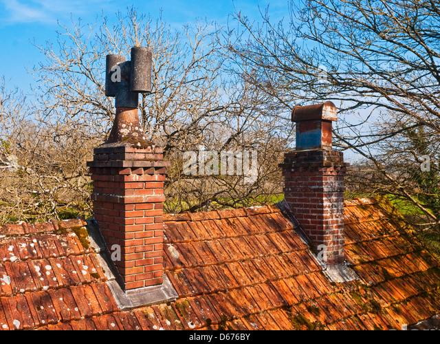 Old brick chimney pot - France. - Stock Image