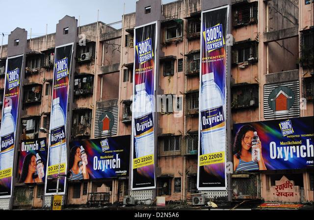 Advertisements on apartment buildings of Mumbai, Maharashtra, India, Asia - Stock Image