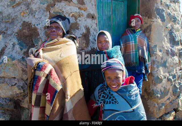 A Basotho family gathers at the center of their village to help oversee local affairs. - Stock Image