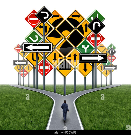 Business decision challenge concept as a businessman on a crossroad path facing an impass or dilemma with a group - Stock Image