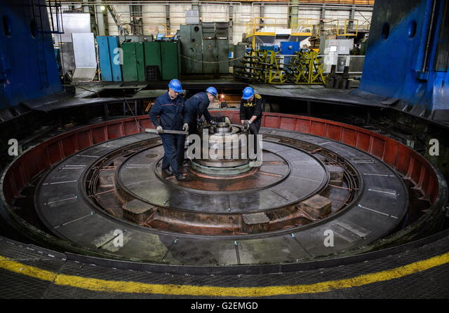 YEKATERINBURG, RUSSIA - MAY 20, 2016: Workers during the assembly of a turbine. Ural Turbine Works is a power machine - Stock-Bilder