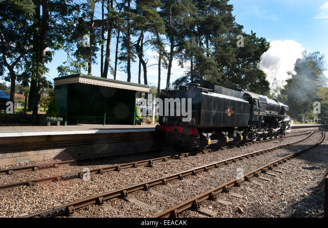9F 2-10-0 Steam Locomotive number 92203 'Black Prince' at Holt station on the North Norfolk Railway between - Stock Image
