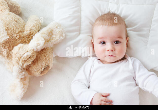 seven month old baby in the bed - Stock Image