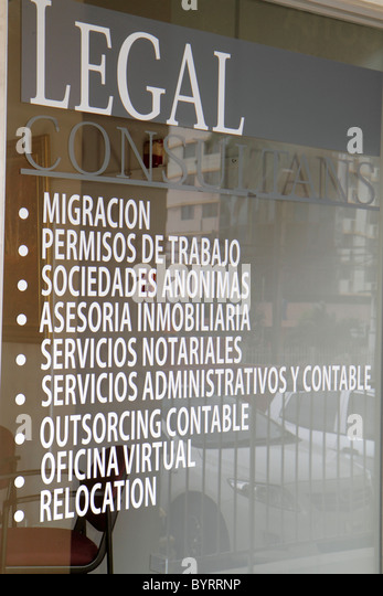 Panama City Panama Bella Vista Via Espana law office window storefront glass graphic sign Spanish language business - Stock Image