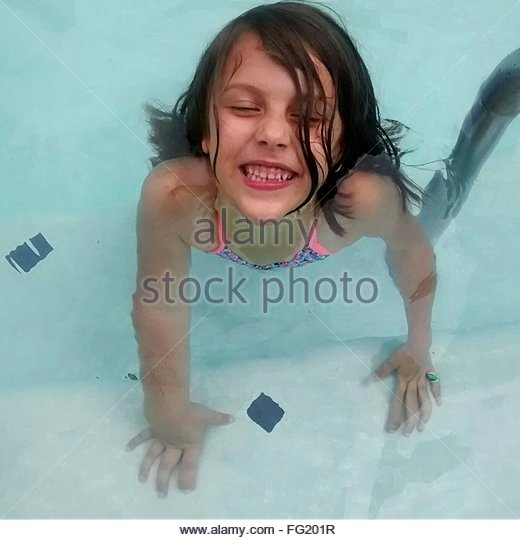 High Angle View Of Smiling Girl In Swimming Pool - Stock-Bilder