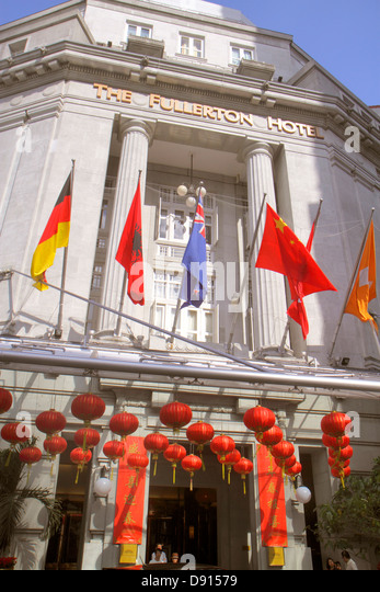 Singapore Singapore River Boat Quay The Fullerton Hotel front entrance decorated Chinese New Year flags - Stock Image