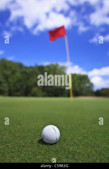 Golf ball on green, close up view. - Stock Image